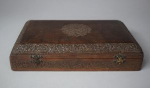 A North Indian Profusely Carved Rectangular Domed Topped Jewellery Box with Hinged Lid Revealing