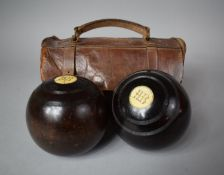 A Set of Two Early 20th Century Bowls Monogrammed HB in Leather Case (One strap AF)