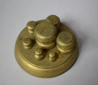 A Set of Five Victorian Brass Avoir Weights on Fitted Circular Stand (Incomplete) Together with
