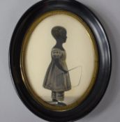 A 19th Century Oval Framed Silhouette of Standing Young Girl with Whip in Hand, with Easel Back