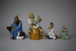 A Collection of Four Glazed Chinese Mud Men