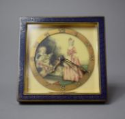 An Early 20th Century Travelling Clock, the Face Having Painted Scene Depicting Children at Picnic