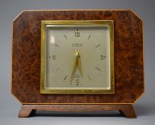 An Art Deco Burr Walnut Mantel Clock by Elliot Clock and Retailed by T A Henn and Sons, 19cms