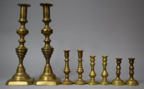 A Collection of Four Pairs of 19th Century and Later Candlesticks, The Tallest 29.5cms High