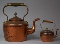 A Large Copper Kettle with Acorn Finial and Brass Loop Carrying Handle together with a Smaller