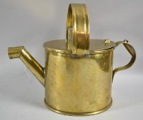 A Brass Watering Can with Side and Central Carrying Handle and with Hinged Cover, 23cms High