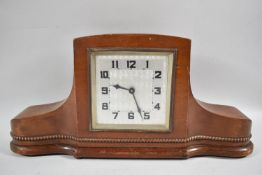 A Mahogany Cased Art Deco Mantle Clock with A Silvered Square Base, 40cms Wide, Movement In Need