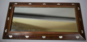 """An Arts and Crafts """"Liberty of London"""" Rectangular Wall Mirror, The Mahogany Frame Inlaid with"""