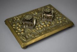 An Early 20th Century Brass Desk Top Inkstand with Two Ink Bottles, Both Brass Hinged Lids Loose,