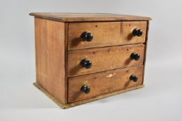 A Late 19th Century Stripped Pine Three Drawer Collectors Cabinet with Turned Handles. 36cm wide