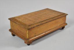 An Edwardian Lift Top Oak Musical Jewellery Box of Sarcophagus Form, 25cm wide (working Order)