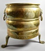 A 20th Century Brass Cylindrical Coal Bucket with Lion Mask Ring Carrying Handles and Three Claw