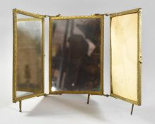 A Gilt Metal Framed and Hinged Triple Travelling Dressing Mirror, In Need of Some Attention and