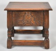 A Mid 20th Century Oak Lift Top Sewing Box with Carved Front and Back Panels, 46cm Wide