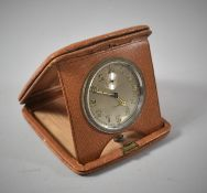 A Vintage Leather Cased Travel Alarm Clock with Working Eight Day Movement