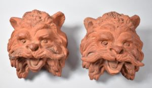 A Pair of Vintage Terracotta Wall Hanging Planters in the Form of Mustachioed Lion Masks, Each