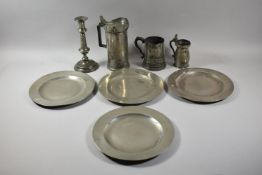 A Collection of Pewter to Include French Jug, Candle Stick, Tankard, Chargers etc