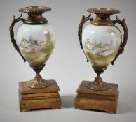 A Pair of French Ceramic and Ormolu Clock Garnitures of Vase Form, One Missing Handle, 20.5cm High