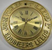 A Circular Brass Framed Advertising Clock for John Fowler & Co. (Leeds), Battery Movement Requires