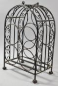 A Modern Wrought Iron Five Bottle Wine Rack with Carrying Handle, 38cm high