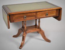 A Reproduction Mahogany Drop Leaf Coffee Table in the Form of a Sofa Table with Tooled Leather Top