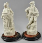 "A Pair of Continental Bisque Figural Ornaments, ""Shepherds"", 26cm High"