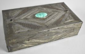 A Rectangular Pewter Covered Wooden Box with Ceramic and Green Glass Cabochons and Relief