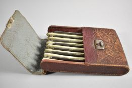 """An Edwardian Leather Cased Set of Seven """"Extra Hollow Ground"""" Cut Throat Razors, Each Engraved"""