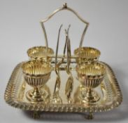 An Edwardian Silver Plated Boiled Egg Cruet for Four with Egg Cups and Spoons, Pierced Rim to