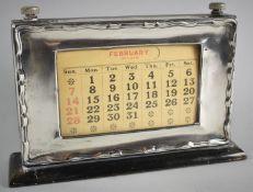 A Silver Mounted Desktop Calendar on Wooden Plinth Base, 21cm Wide