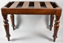 A Victorian Mahogany Luggage Stand on Turned Supports, 63cm wide