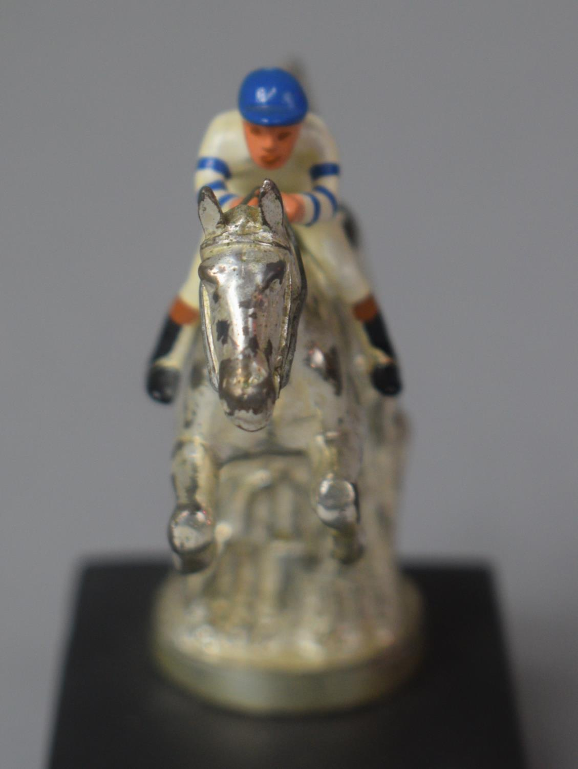A Chromed Car Mascot in the Form of Racehorse and Jockey Taking Fence, 12.5cm high - Image 3 of 4