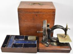 A 19th Century Mahogany Cased American 'C' Frame Sewing Machine by Willcox & Gibbs, Original Case