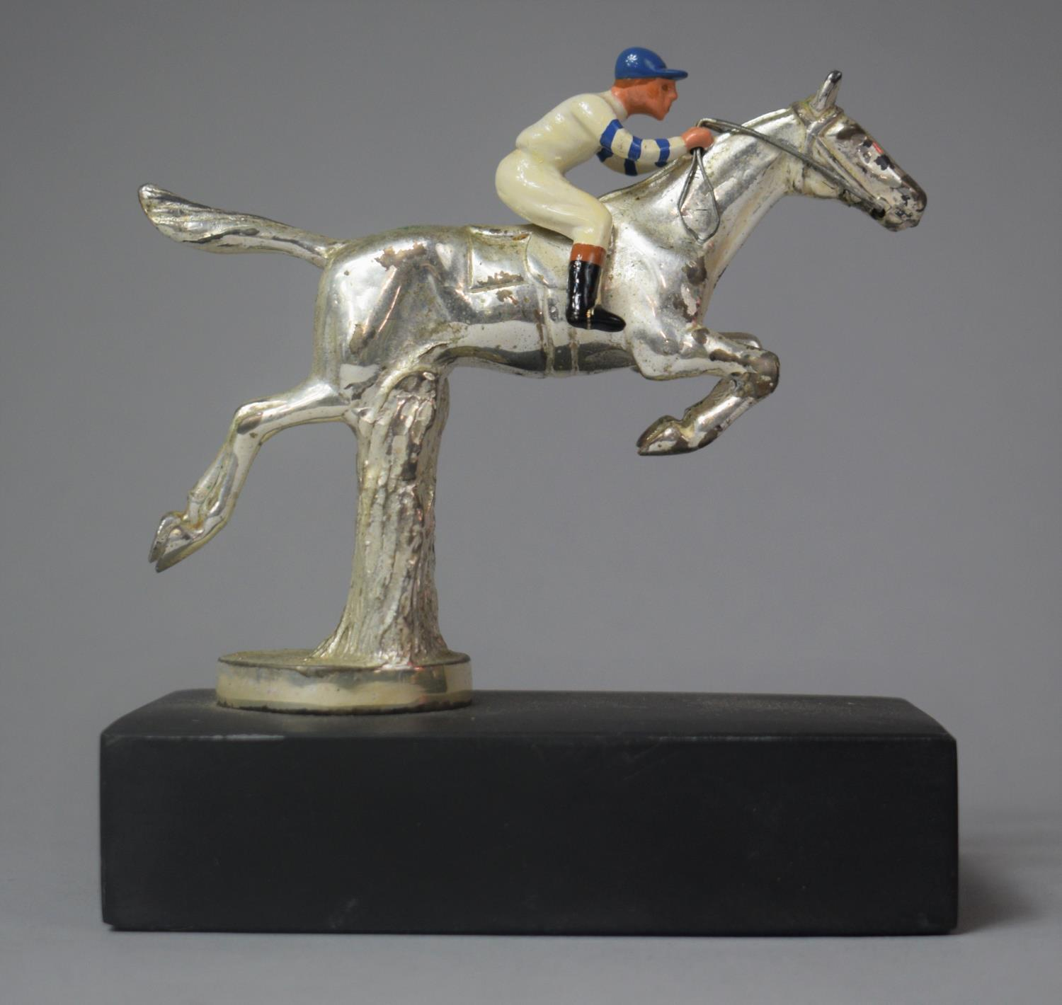 A Chromed Car Mascot in the Form of Racehorse and Jockey Taking Fence, 12.5cm high