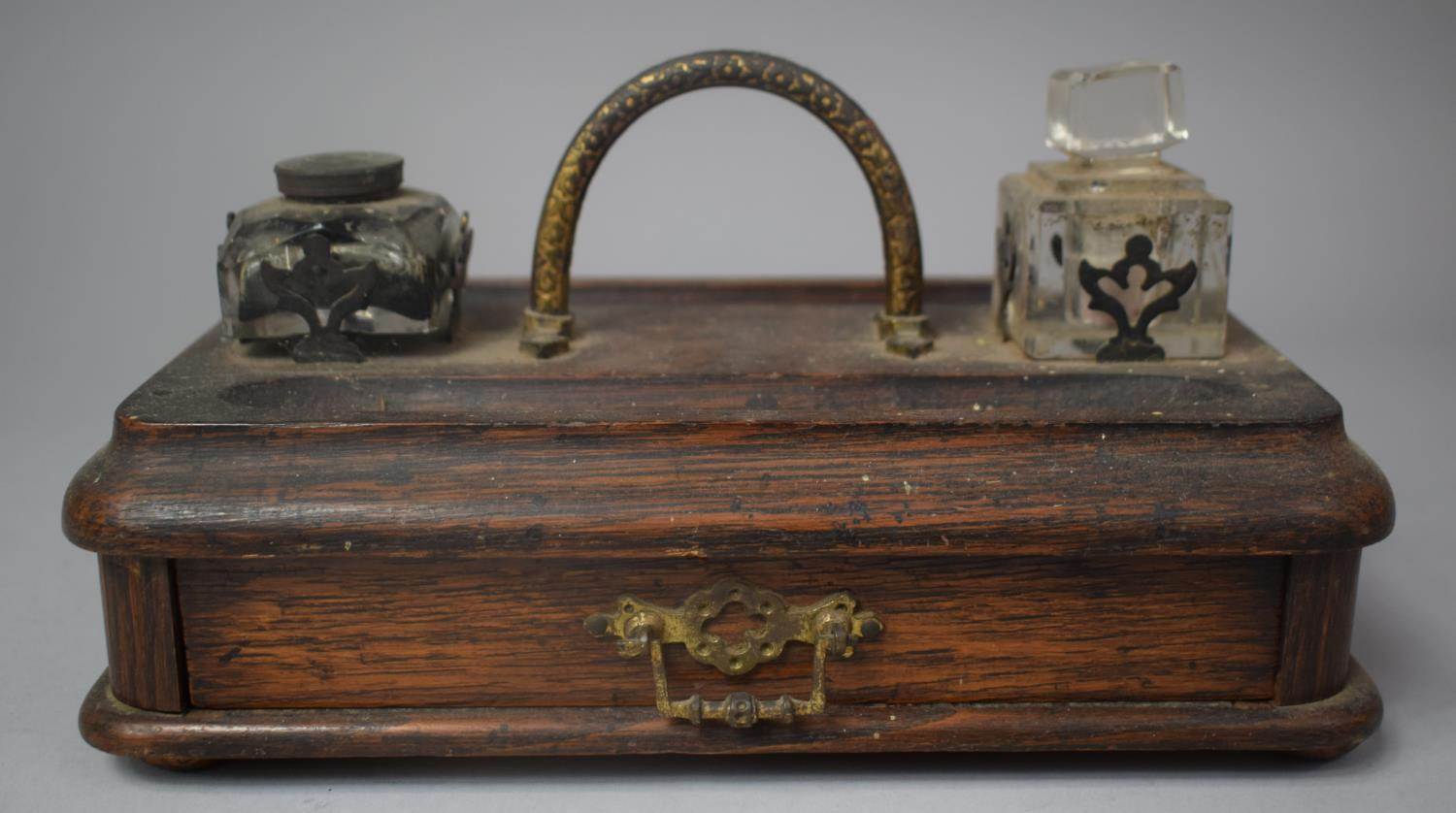 A Late Victorian Desktop Penrest and Inkstand with Two Ink Bottles and Base Drawer, 25cm Wide