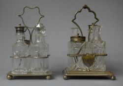 Two Edwardian Four Bottle Cruet Sets with Silver Plate Stands