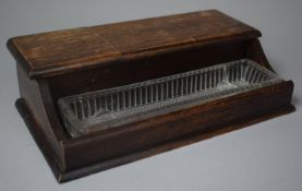 An Edwardian Oak Desk Top Inkstand with Glass Pen Tray and Three Glass Inkwells, 27cm Wide
