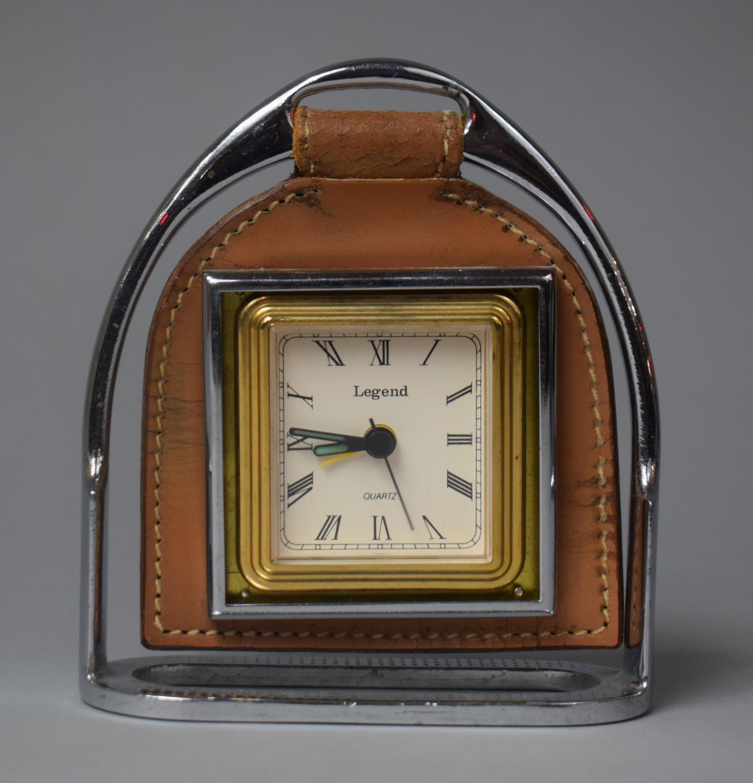 A Novelty Quartz Alarm Clock in the Form of a Stirrup, 14cm high