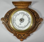 An Edwardian Carved Oak Wall Hanging Aneroid Barometer with Brass Bezel, 28.5cm wide