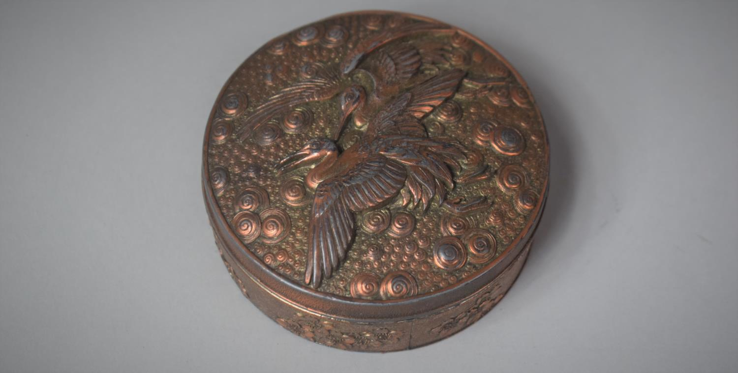 A Modern Copper Patinated Circular Oriental Box, the Lid Decorated with Cranes in Relief, 8.5cm