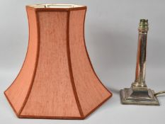 A Sheffield Plated Table Lamp Base in the Form of a Column on Stepped Square Base, 25cm high (with