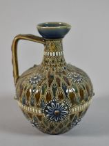 A Doulton of Lambeth Jug in the Usual Brown and Blue Enamels, Shape no. 1884, 13cm high
