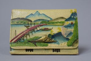 A Japanese Decorated Leather Purse, 13.5cm wide