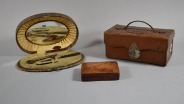 An Early 20th Century Oval Crocodile Skin Manicure Set Together with an Italian Leather Stud Box and
