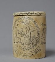 A Resin Scrimshaw Style Tobacco Pot in the Form of a Whale Tooth, 9cm high