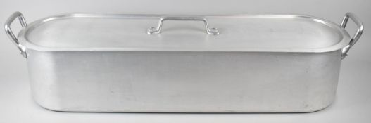 A Mid 20th Century Aluminium Two Handled Salmon Kettle, 87cm wide