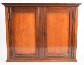 An Edwardian Mahogany Wall Hanging Shelved Cabinet with Panelled Doors, 49.5cm Wide