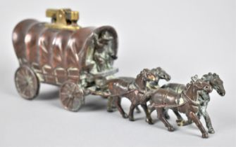 A Novelty Bronze Effect Lighter In the Form of an American Covered Wagon Pulled by Four Horses, 18cm