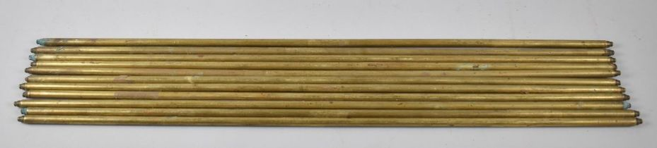 A Collection of Eleven Vintage Brass Stair Rods