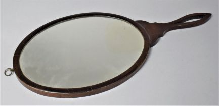 A 19th Century Mahogany Framed Wall Hanging Ladies Mirror with Oval Glass, 52cm Long